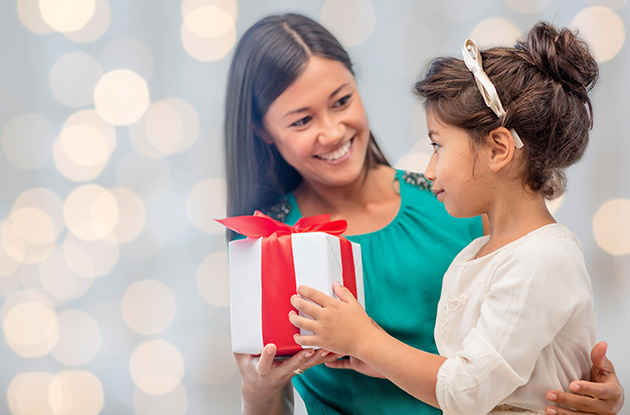 child receiving gift from mom
