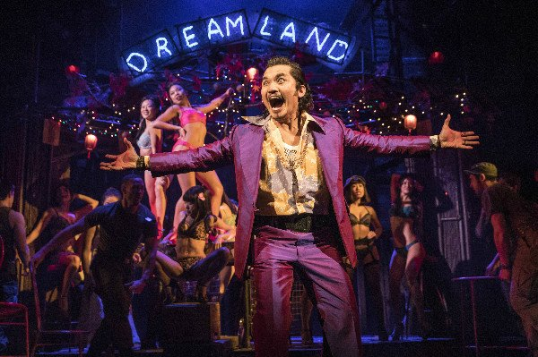 Jon Jon Briones and the company of MISS SAIGON. photo by Matthew Murphy
