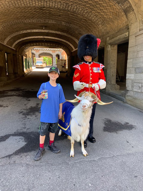 boy with guard and goat in quebec city