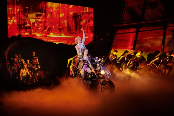 Andrew Polec as Strat and the cast of Bat Out Of Hell
