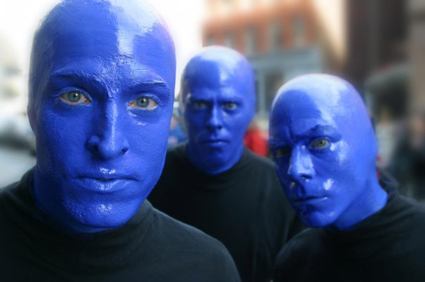 Close-up of the three person Blue Man Group.