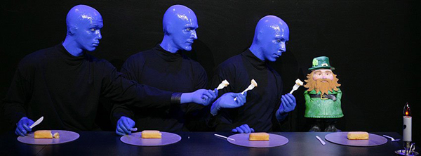 The Blue Man Group performing on stage.