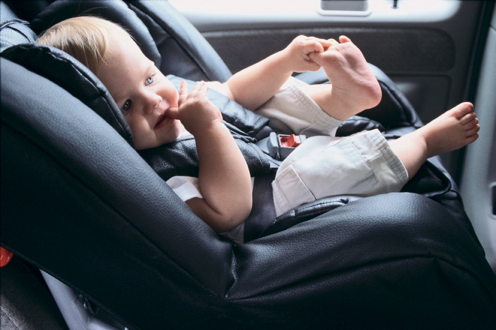 baby buckled into car seat