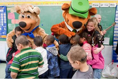 Crystal Bowersox, Yogi Bear, and BooBoo visit a Harlem school; Holiday Joy Toy Drive