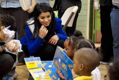 Miss USA Rima Fakih visits Harlem schoolchildren; Holiday Joy Toy Drive