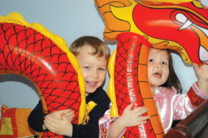Planet Han; kids playing with Chinese dragon