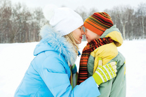 mom and son outside in the winter; bundled up