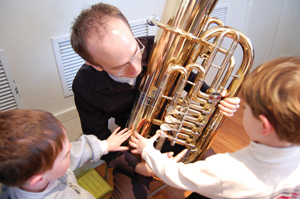 children learning about brass orchestra instruments; Exploring the Orchestra
