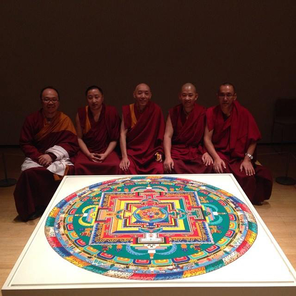 Five artists sitting beside their piece of work at the Asia Society and Museum.