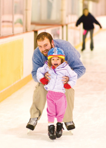 father and young daughter ice skating
