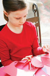 little girl making a Valentine's Day card