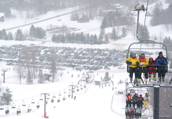 skiers on a chairlift; ski lift