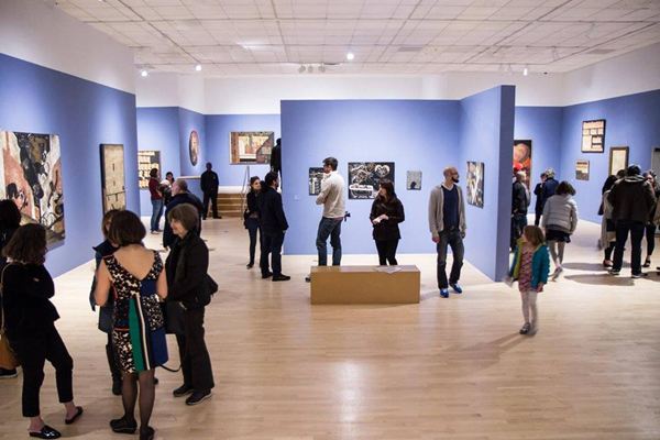 Visitors looking a studio exhibit at the Bronx Museum of the Arts.