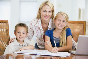 mom helping daughter and son with homework
