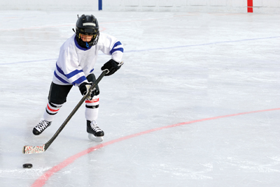 boy playing hockey