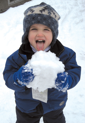 little boy eating snow; fun in the snow at New Canaan Nature Center