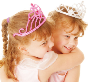 two young girls, sisters, wearing princess crowns; two little princesses