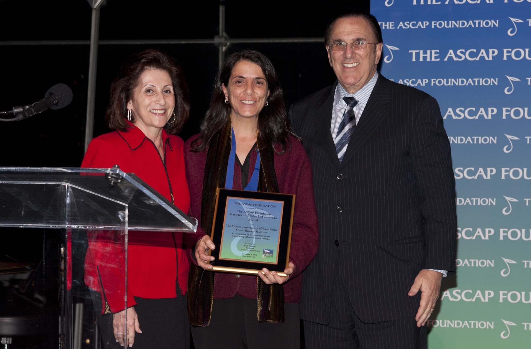 ASCAP CEO John LoFrumento (r) and his wife Barbara (l) present The ASCAP Foundation Barbara and John LoFrumento Award to Lisa Sandagata, Director of Outreach Services for the Music Conservatory of Westchester's Music Therapy Institute.