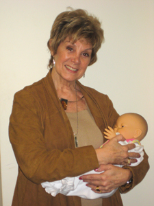 Sterling Care Home Baby Care; Sterling attendant with baby