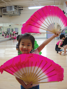 New York Chinese Cultural Center; girl with asian fans, Chinese dance