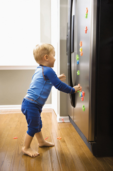 little boy running to refrigerator, freezer; child opening fridge