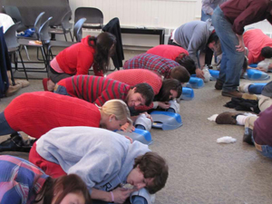 students learning CPR; teen CPR training class