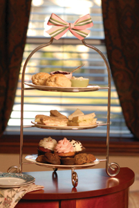 high tea tray with sweets and scones
