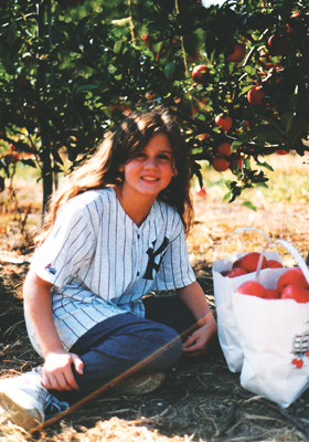 Laura Kish, apple picking in New York Yankees jersey