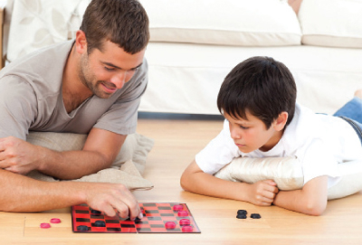 father and son playing checkers