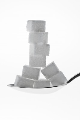 Sugar cubes stacked on spoon