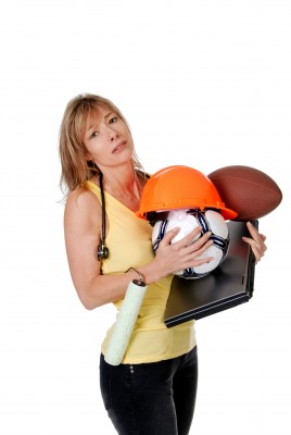 stressed mom holding football soccerball and laptop