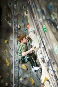 boy climbing on a climbing wall