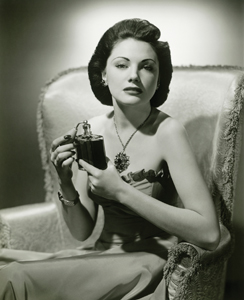 retro woman with perfume bottle