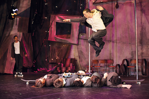 Traces cast member jumping over four other cast members