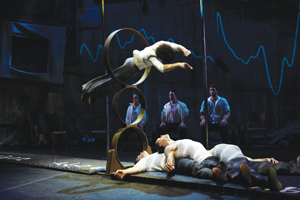 Traces cast member jumping through hoops