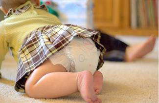 baby girl crawling on the ground