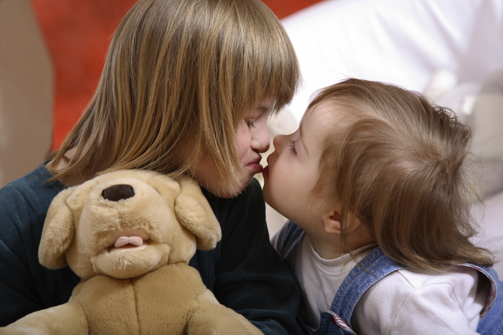 Two kids with down sydnrome kissing.