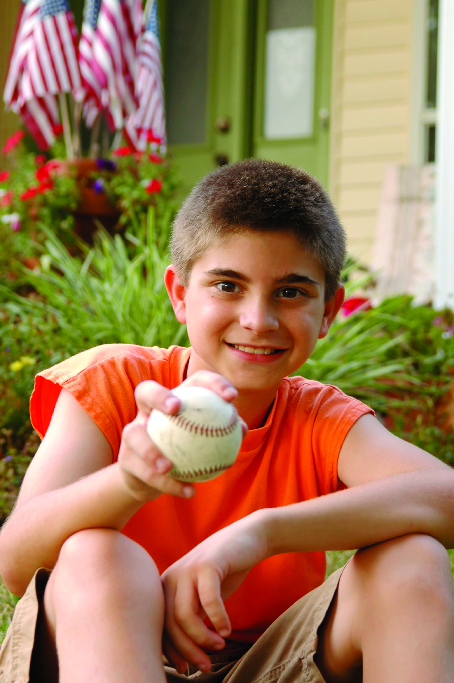 Boy holding baseball