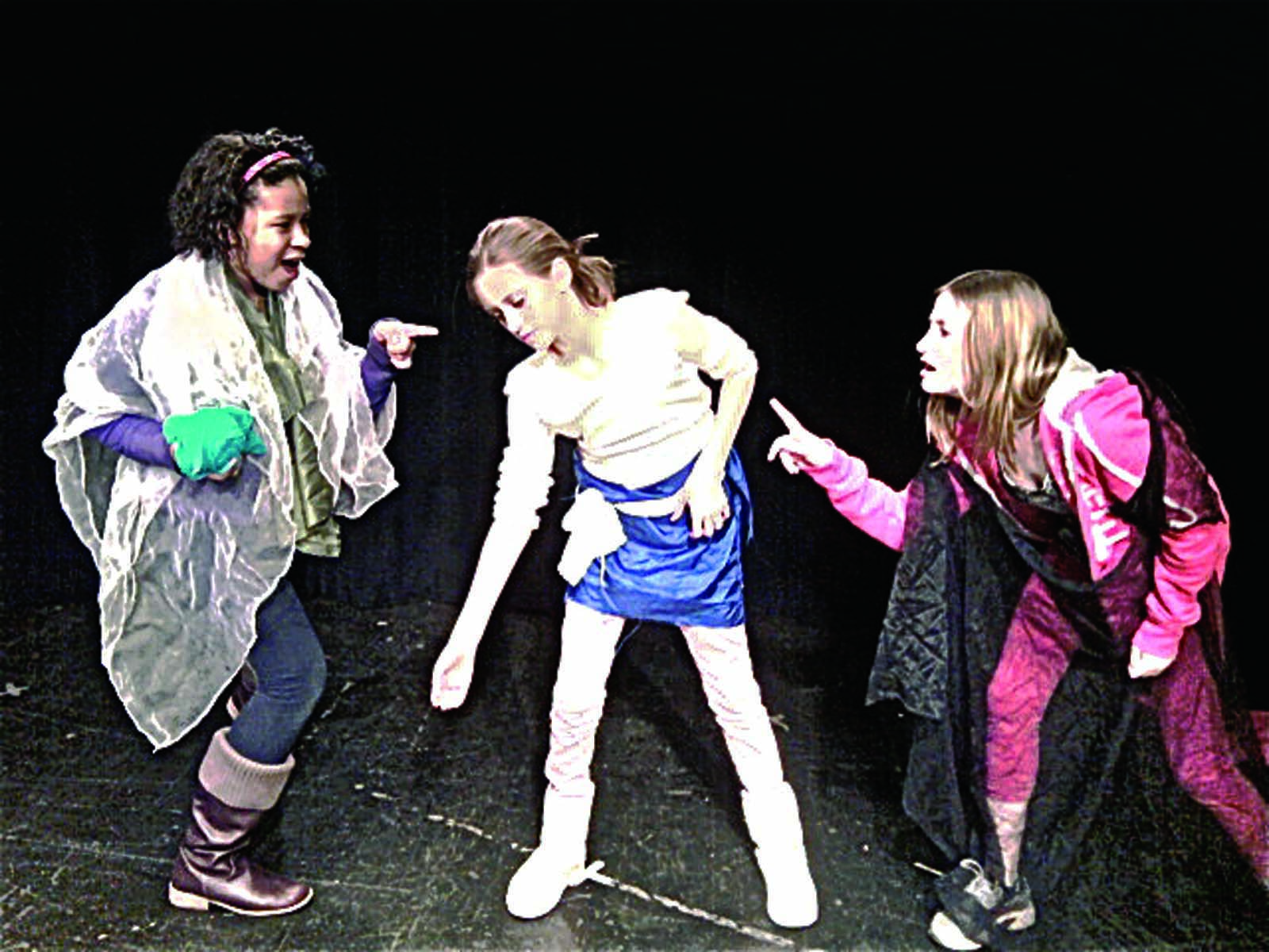 Middle school students Nia, 11, Sarah, 12, and Amalia, 12, perform on stage during a Rockland Youth Theatre class.