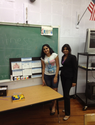 Dr. Suneeta S. Paroly (right) with her student Ramya Subramaniam during the Oceanside School #6 Family Fun and Fitness night.