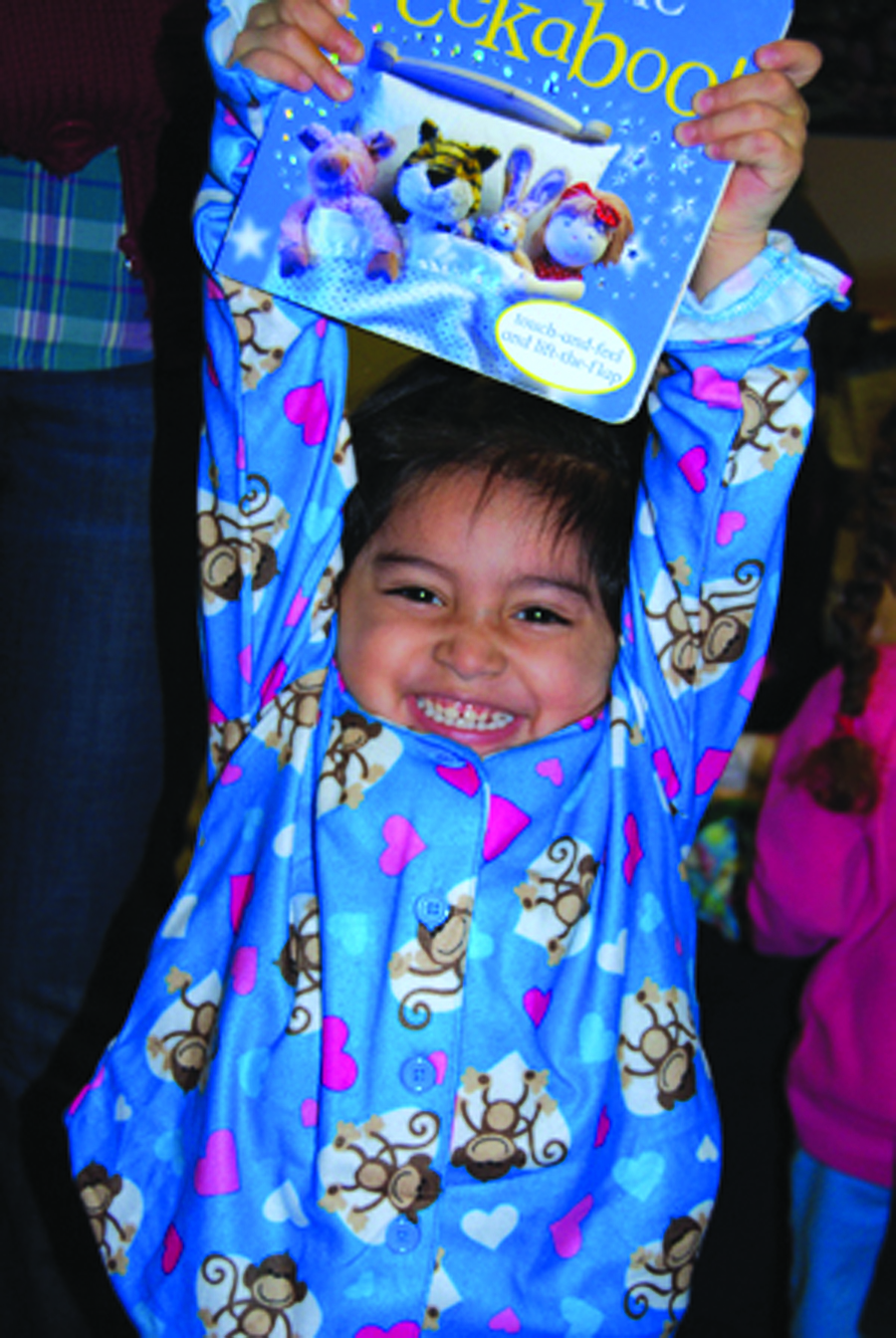 The nonprofit Pajama Program provides needy kids with new PJs and books—items that help bring comfort to a tough situation; Courtesy Pajama Program