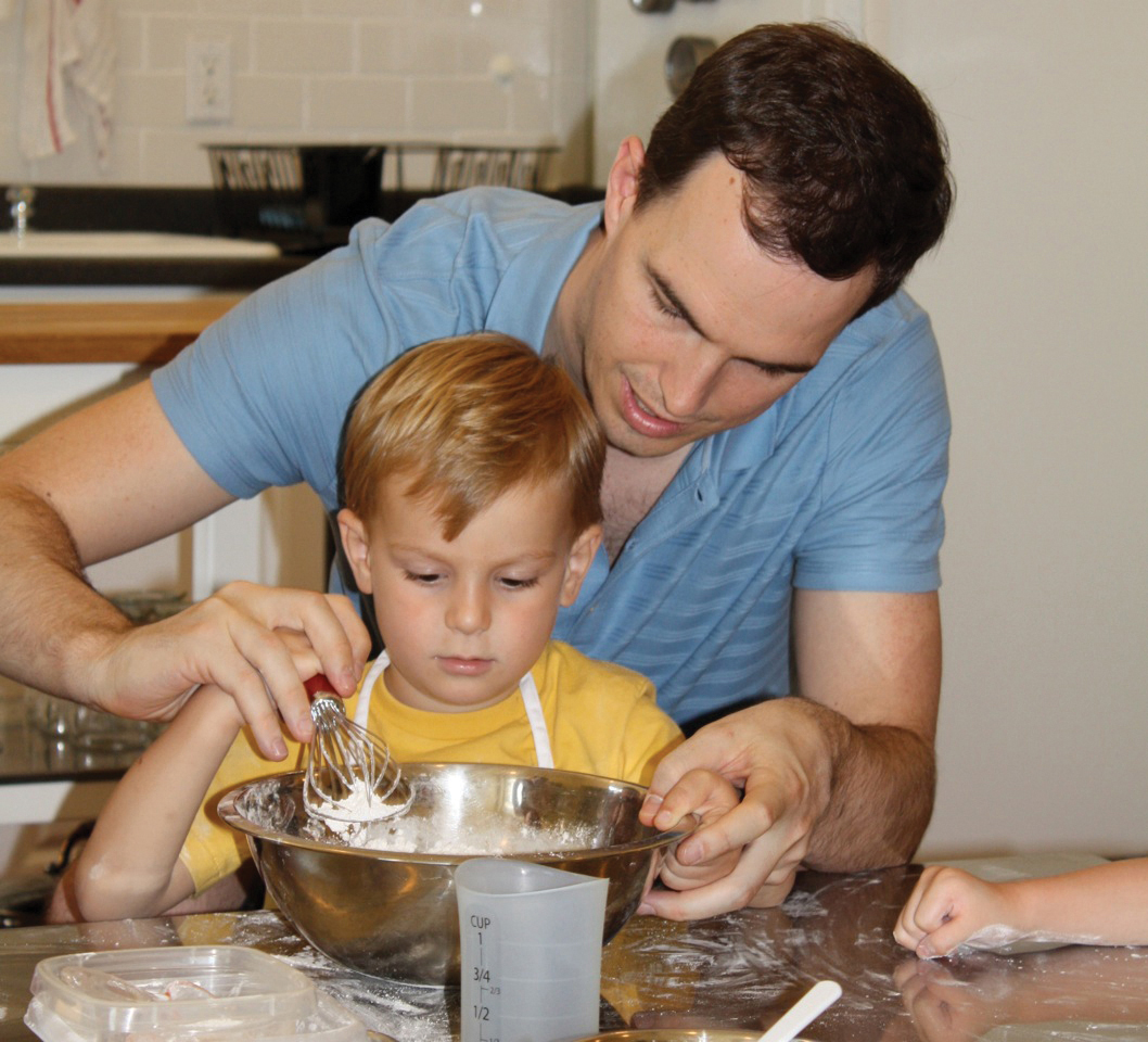 dad and son cooking at Taste Buds
