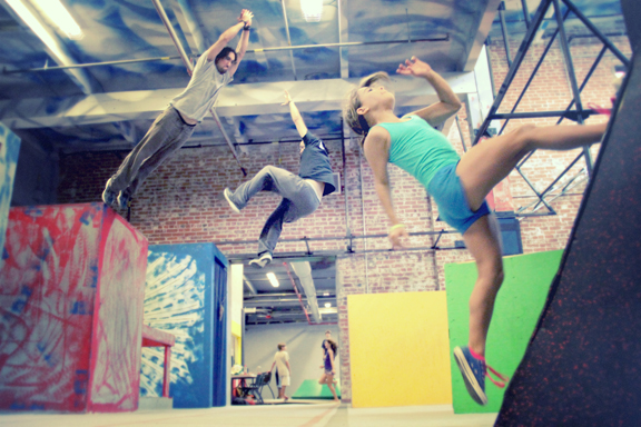 Student Ava Spartachino and instructors Joe Cannato and Murphy Betancourt show off their Parkour skills.