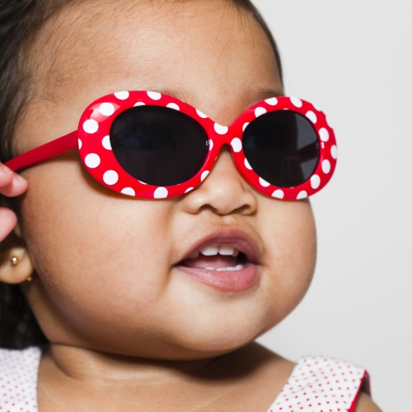 baby wearing red polka dot sunglasses