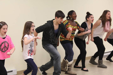 students rehearsing at performing arts school