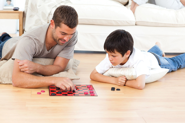 older man and young boy playing checkers