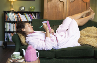 Woman Journaling on a Couch