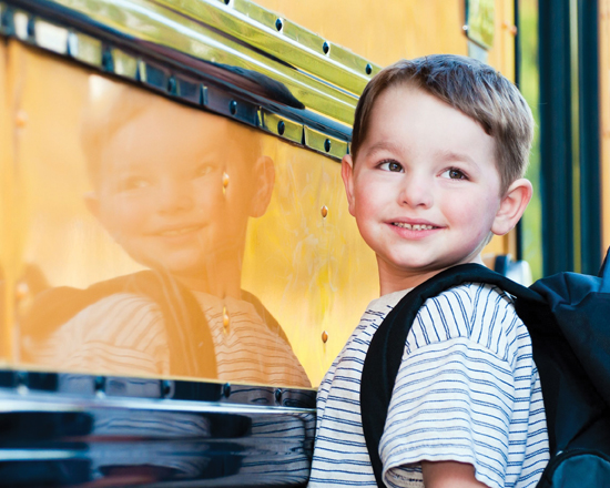 back to school, child getting on the bus