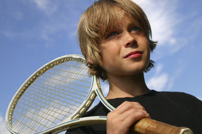 nervous boy with tennis racquet