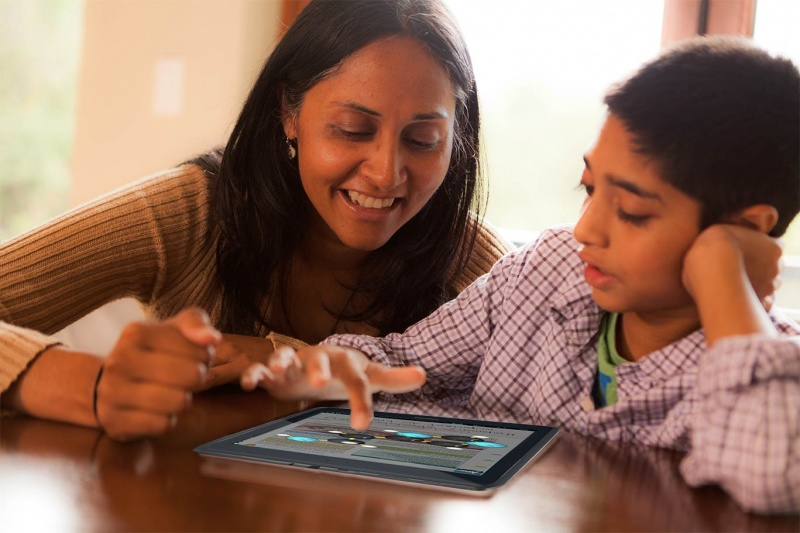 Mom and Son using Kno App on Tablet